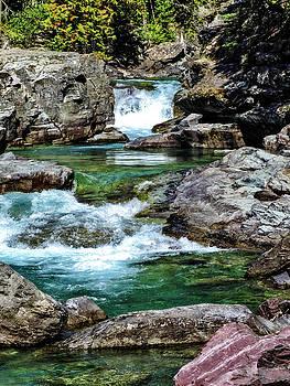 Falls above Lake Mc Donald by L J Oakes
