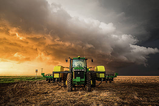 Farm Life - Tractor and Storm in Western Kansas by Sean Ramsey