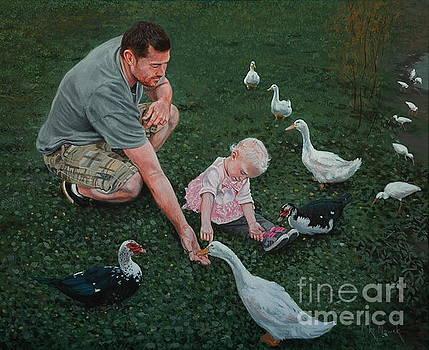 Feeding ducks with Daddy by Michael Nowak