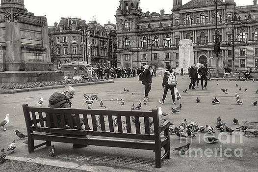 Feeding the Birds at George Square In Greyscale by Joan-Violet Stretch