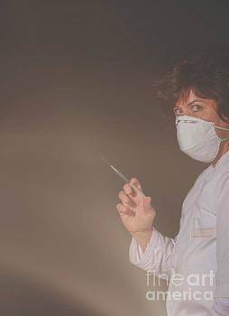 Female doctor with surgical mask and syringe looking spooky by Patricia Hofmeester