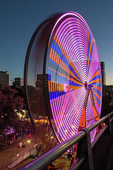 Ferris Wheel at Fun Fair in Downtown Portland Oregon by David Gn