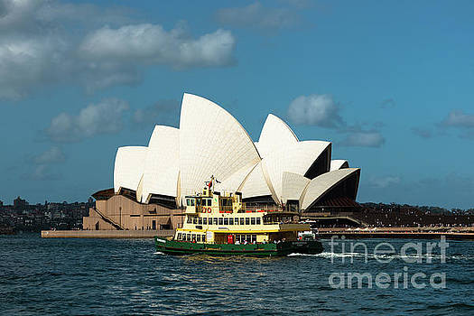 Ferry goes past the Sydney Opera House by Andrew Michael