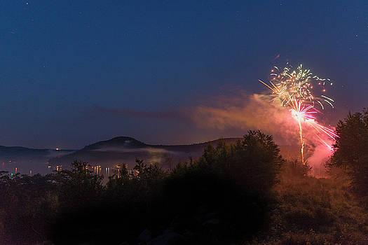 Fireworks at Merrymeeting lake, NH. by Ken Kartes