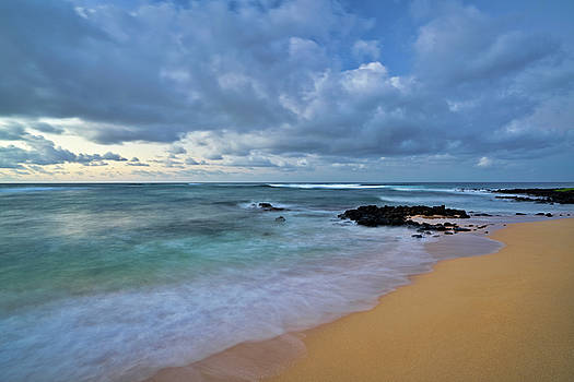 First light beauty at Poipu Beach along the South Shore. by Larry Geddis