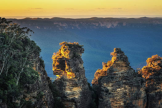 First sunrays in the morning at Three Sisters in  Blue, Mountain by Daniela Constantinescu