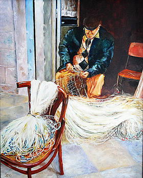 Fisherman checking his nets by Steve James