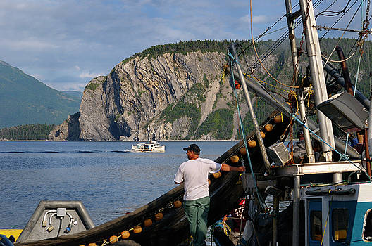 Reimar Gaertner - Fishermen hauling in net on East Arm Bonne Bay at Norris Point a