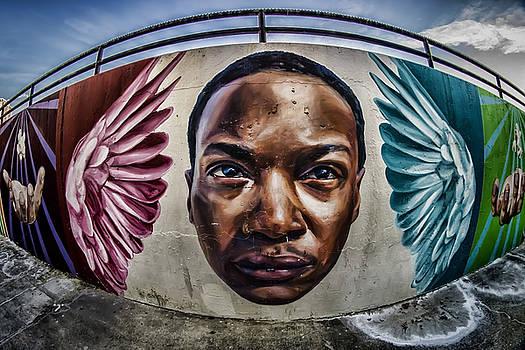 Fisheye view of striking outdoor mural  by Sven Brogren