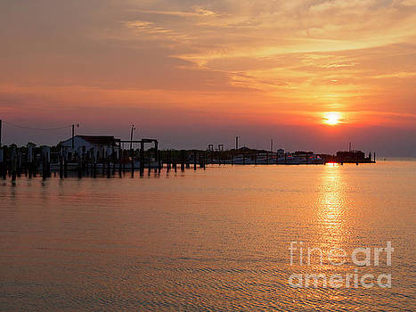 Fishing shanties at sunset on Tangier Island Chesapeake Bay by Louise Heusinkveld