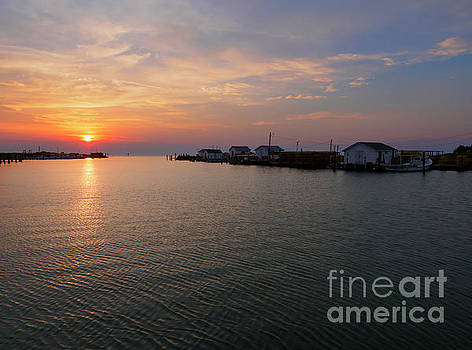 Fishing shanties at sunset on Tangier Island in Chesapeake Bay by Louise Heusinkveld