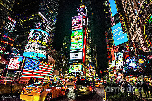 Julian Starks - Flag illuminates Times Square