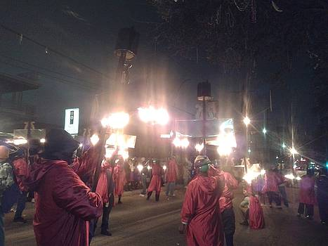 Flambeau Carriers Illuminate The Streets During  Lundi Gras  by Michael Hoard