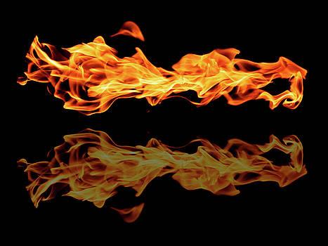 Flame reflection by Lukasz Szczepanski