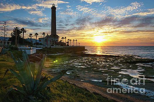 Flaring Sun at Chipiona Lighthouse Cadiz Spain by Pablo Avanzini