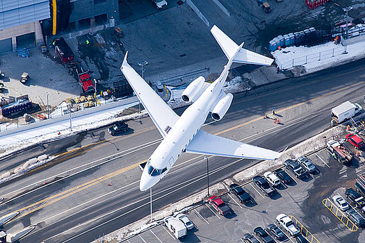 Flight attendants prepare for touchdown by John Majoris