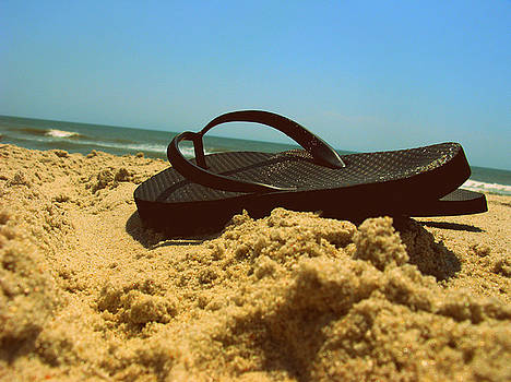 Flip flop in the sand by Terry and Brittany Sprinkle