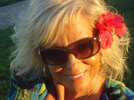 Flower in hair by Debbie Wassmann