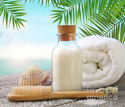 Sandra Cunningham - Fluffy towels with sea salt and seashells on beach table