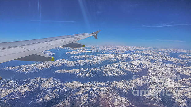 Flying over the Alps by Claudia M Photography