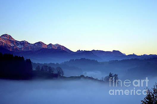 Fog creeps up the valley - Switzerland by Susanne Van Hulst