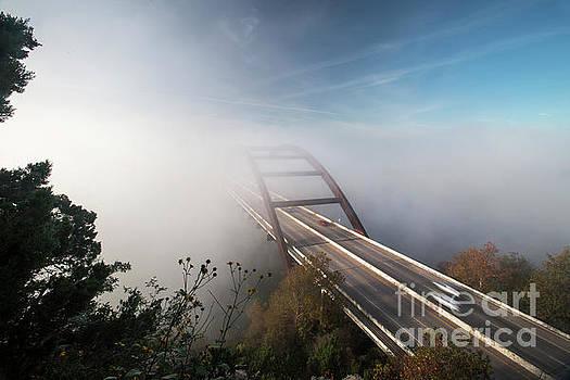 Herronstock Prints - Fog engulfs the 360 Bridge during sunrise on a cold winters mo