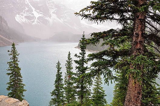 Fog going down at Lake Moraine by Daniela Constantinescu