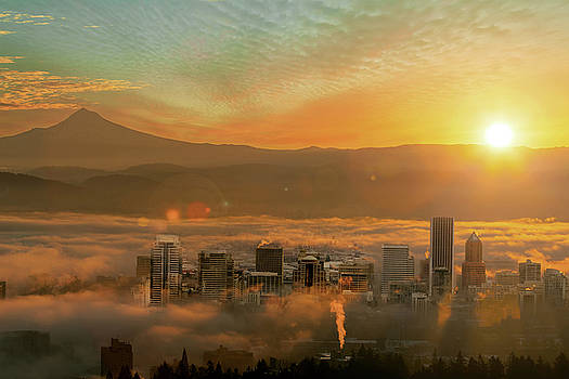 Foggy Morning over Portland Cityscape during Sunrise by David Gn