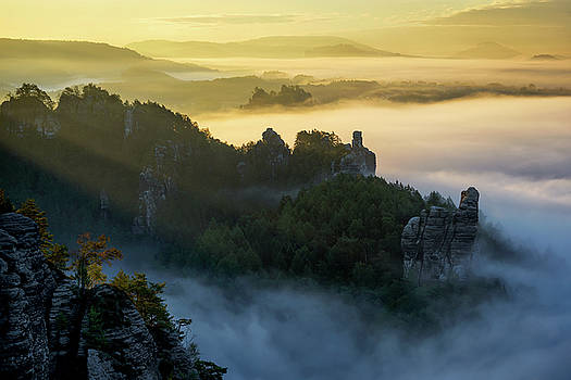 Foggy sunrise at Bastei, Saxon Switzerland, Germany. Typical saxony autumn landscape. by Marek Kijevsky