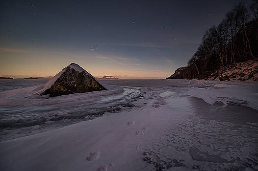 Footprints in snow around the pyramid rock by Jakub Sisak