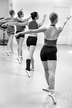 Four female dancers during a ballet rehearsal by Julia Hiebaum