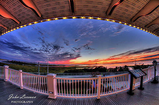 Framed Sunset by John Loreaux