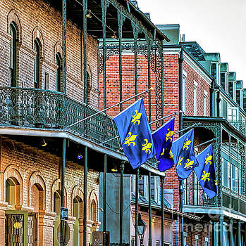 French Quarter Balconies and Flags-NOLA by Kathleen K Parker
