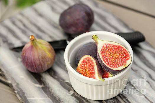 Sophie McAulay - Fresh cut figs on table