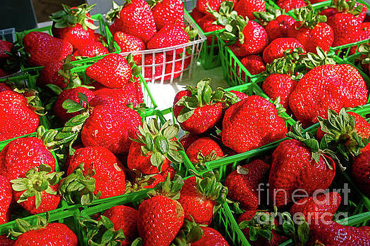 Fresh strawberries for sale in a market by Louise Heusinkveld