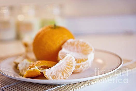 Freshly peeled citrus by Cindy Garber Iverson