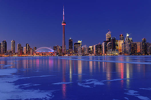 Reimar Gaertner - Frozen ice covered Lake Ontario reflecting the lights of Toronto