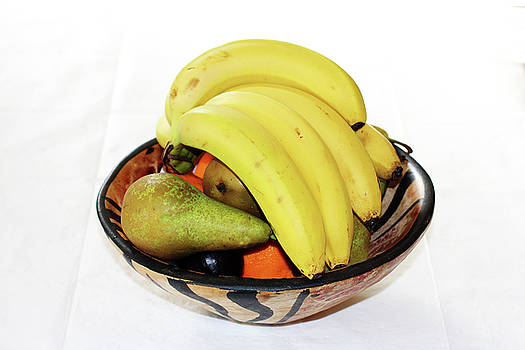 Fruit in a wooden bowl by Tom Conway