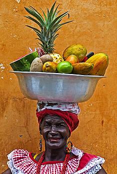 Fruit seller by Kobby Dagan