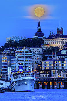 Full moon over the Katarina Church and Sodermalm in Stockholm by Dejan Kostic