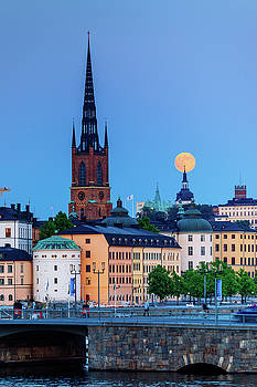 Full moon over the Katarina Church and Sodermalm in Stockholm with the Riddarholmen Church in Front by Dejan Kostic