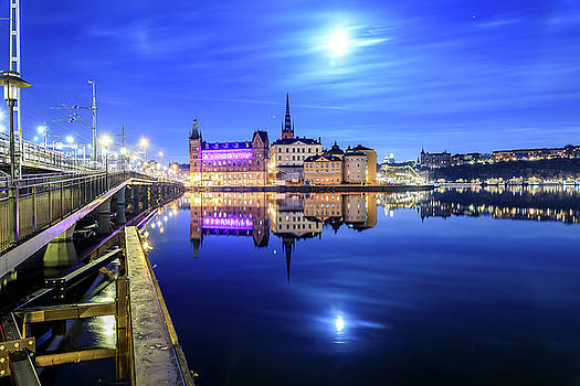 Full moon perfect reflection over Riddarholmen in Stockholm in the Blue Hour by Dejan Kostic