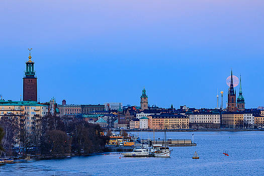 Full moon rising over Gamla Stan and the City Hall in Stockholm by Dejan Kostic