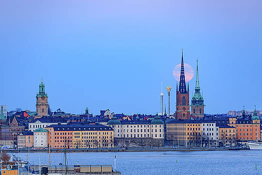 Full moon rising over Gamla Stan Churches in Stockholm by Dejan Kostic