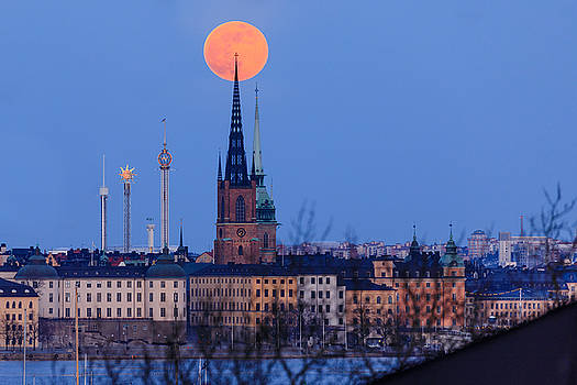 Full moon rising over Gamla Stan in Stockholm by Dejan Kostic