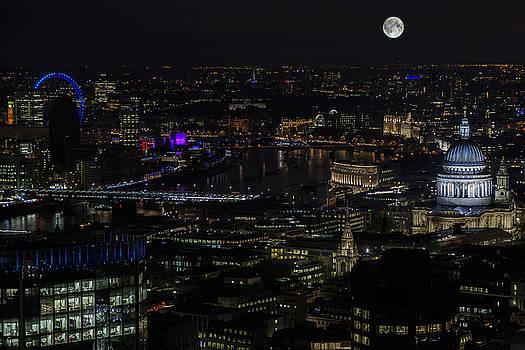 Full Color Moon rising over London Skyline  by Andy Myatt