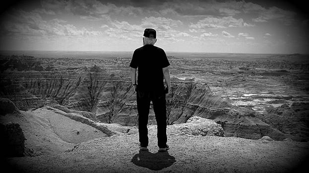 Gary Looks at the Badlands by Emily Spivy