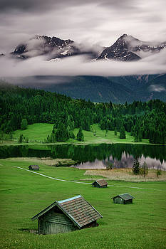 Geroldsee during rainy day with foggy clouds over mountain peaks, Bavarian Alps, Bavaria, Germany. by Marek Kijevsky