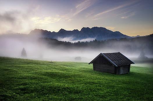 Geroldsee forest with beautiful foggy sunrise over mountain peaks, Bavarian Alps, Bavaria, Germany. by Marek Kijevsky