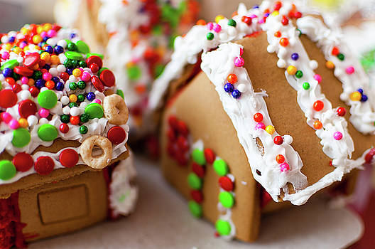 Gingerbread houses decorated with frosting and candy by Bradley Hebdon